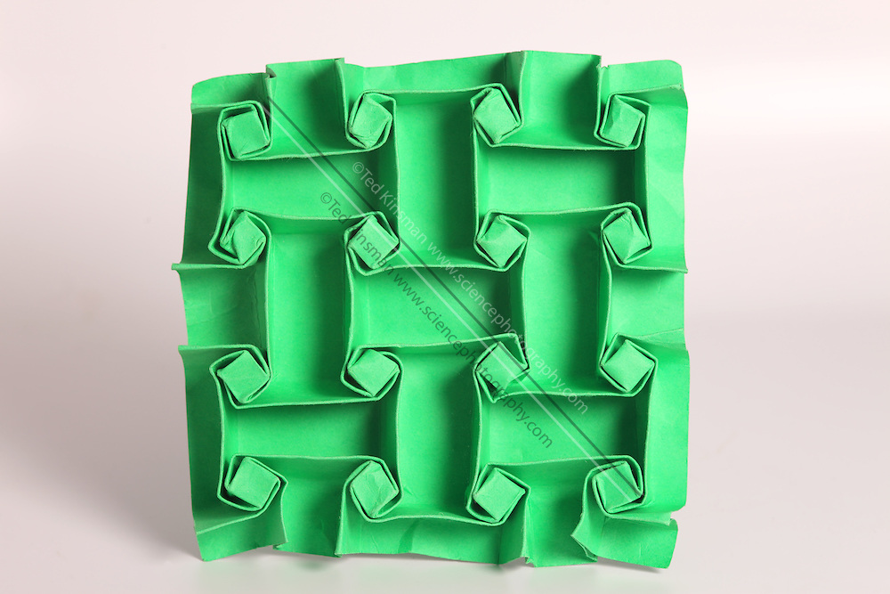 This is an example of mathematical origami which is a new and exciting field of mathematics.  This surface is made from a single sheet of paper with numerous folds and no cuts..
