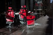 With the UK death toll reaching 38,161, a further 324 victims in the last 24hrs, and the governments pandemic lockdown still in effect, empty barbers chairs remain empty in a closed hairdressers in the City of London - the capitals financial district, on 29th May 2020, in London, England.