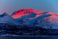 Winter landscape along the coastline between  Harstad and Finnsnes, Arctic, Northern Norway in predawn light.