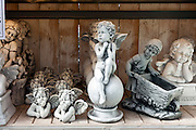 various garden ornaments on a shelf displayed