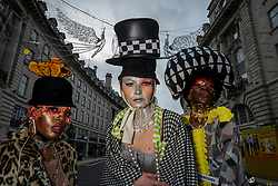 © Licensed to London News Pictures. 26/12/2020. LONDON, UK.  Models take part in a Boxing Day flashmob at Regent Street for designer Pierre Garroudi.  Photo credit: Stephen Chung/LNP