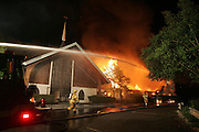 Firefighters work to control a blaze started by a homeless person who had broken in to cook a late night snack early Thursday morning at the Charlottesville Church of Christ.