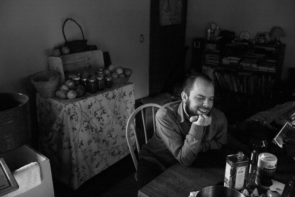 Nick F. laughs while waiting to eat dinner with a group eats dinner at  Circle Acres Farm.