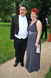 PETER KAY and his wife SUSAN at the Raisa Gorbachev Foundation fourth annual fundraising gala dinner held at Stud House, Hampton Court, Surrey on 6th June 2009.