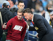 Manchester United's Louis Van Gaal poses with Manchester City fans<br /> <br /> - Barclays Premier League - Manchester City vs Manchester Utd - Etihad Stadium - Manchester - England - 2nd November 2014  - Picture David Klein/Sportimage