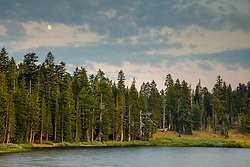 """""""Showers Lake Sunset 2"""" - Photograph of a sunset and the moon rising at Showers Lake which is along the Tahoe Rim Trail and the Pacific Crest Trail, south of South Lake Tahoe a bit."""
