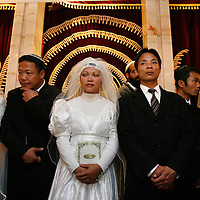 18 couples of Jewish immigrants from India, member of the 'Bnei HaMenashe' community, stand under the canopy as they get married in a shared wedding ceremony at the The Great Synagogue in Jerusalem, March 02, 2008. For the last 50 years Bnei Hamenashe seek their roots in Judaism as one of the lost tribes of Israel. Today 7000 Bnei Hamenashe in the States of Manipur and Mizoram in North India live full Jewish lives. Those who immigrate to Israel undergo Orthodox conversion in the framework of which they have to remarry according to Jewish Law.<br /> Photo by Michal Fattal.<br /> <br />  *** Local Caption ***