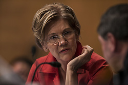 October 3, 2017 - Washington, District Of Columbia, USA - Senator ELIZABETH WARREN (D-MA) speaks to a staffer while Timothy Sloan President and Chief Executive Officer of Wells Fargo testifies before United States Senate Banking Committee. (Credit Image: © Alex Edelman via ZUMA Wire)