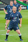 Louie Spence leads the warm up - Training starts for inaugural RUGBY AID 2015 charity match which takes place on Friday 4th September 2015 at the Twickenham Stoop. The celebrity charity game will be in aid of RUGBY FOR HEROES  of which Mike Tindall MBE is Patron. The charity raises funds and awareness through the sport of rugby, the fan community and the wider professional player network, to support military personnel who are making the transition back from military service to civilian life. The teams (England v's Rest of the World) include former international rugby players, celebrities and serving members of the armed forces. Harlequins Rugby , The Stoop, Twickenham, London UK, 02 Sept 2015