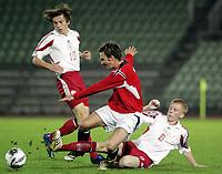 Fotball<br /> Kvalifisering UEFA EM-kvalifisering G18 / U19<br /> Norge v Latvia 2-1<br /> Bislett Stadion<br /> Foto: Morten Olsen, Digitalsport<br /> <br /> Magnus Lekven - Norge og Odd Grenland<br /> Aleksejs Kuplovs-Oginskis - Latvia (6)