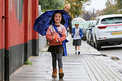 © Licensed to London News Pictures. 27/09/2021. London, UK. 4 year old Mila Tobias on her way to school, holds an umbrella during rainfall in north London. Rain is forecasted for London and South East England for the rest of the week following from the recent mini-heatwave in the capital. Photo credit: Dinendra Haria/LNP