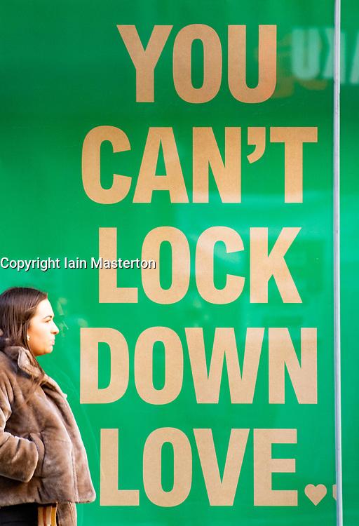 Glasgow, Scotland, UK.1 December 2020. Coronavirus health warnings, shop display and graffiti in Glasgow city centre.  Iain Masterton/Alamy Live News