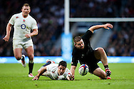 England's Brad Barritt and New Zealand's Dane Coles go for a loose ball, but Coles comes off better - QBE Autumn Internationals - England vs New Zealand - Twickenham Stadium - London - 08/11/2014 - Pic Charlie Forgham-Bailey/Sportimage