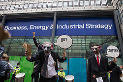 London, UK. 26th August, 2021. Environmental activists from Corp Rat protest outside the Department for Business, Energy and Industrial Strategy (BEIS) following an Extinction Rebellion Stop The Harm march on the fourth day of Impossible Rebellion protests. Extinction Rebellion are calling on the UK government to cease all new fossil fuel investment with immediate effect.