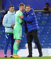 Football - 2020 / 2021 EFL Cup - Round 3 - Chelsea vs Barnsley <br /> <br /> Chelsea Manager, Frank Lampard consoles Barnsley goalkeeper, Brad Collins after the match, who used to be on Chelsea's books at Stamford Bridge.<br /> <br /> COLORSPORT/ANDREW COWIE