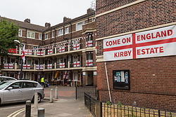 Still proudly flying the England flag on the day following England's defeat by Croatia in the World Cup, London's Kirby Estate in Southwark plans a street party for residents during the Third place play-off. A screening of last night's semi-final was cut short after troublemakers arrived. London, July 12 2018.