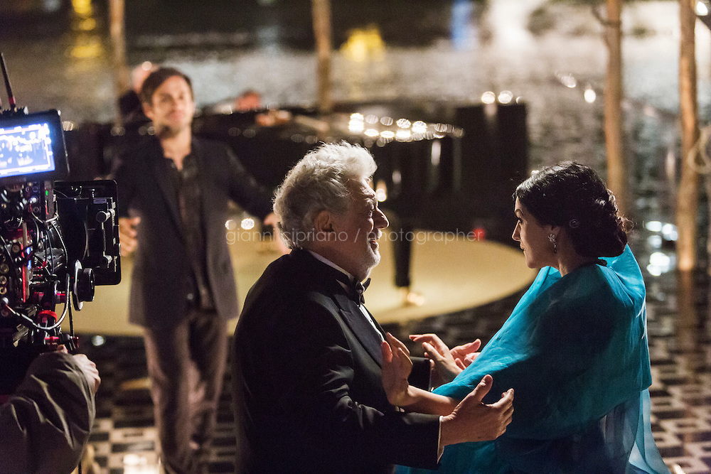 """VENICE, ITALY - 13 JULY 2016: (R-L) Tenor and conductor Placido Domingo (75), actress Monica Bellucci (51) and actor Gael Garcia Bernal (37) shoot a scene of an episode of the third season of """"Mozart in the Jungle"""" on a barge and set navigating on the Grand Canal in Venice, Italy, on July 13th 2016.<br /> <br /> Mozart in the Jungle is an award-winning television series produced by Picrow for Amazon Studios. The pilot was written by Roman Coppola, Jason Schwartzman, and Alex Timbers and directed by Paul Weitz. The story was inspired by Mozart in the Jungle: Sex, Drugs, and Classical Music, oboist Blair Tindall's 2005 memoir of her professional career in New York."""