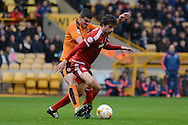Wolverhampton Wanderers midfielder Conor Coady tries to tackle Middlesbrough striker Diego Fabbrini during the Sky Bet Championship match between Wolverhampton Wanderers and Middlesbrough at Molineux, Wolverhampton, England on 24 October 2015. Photo by Alan Franklin.