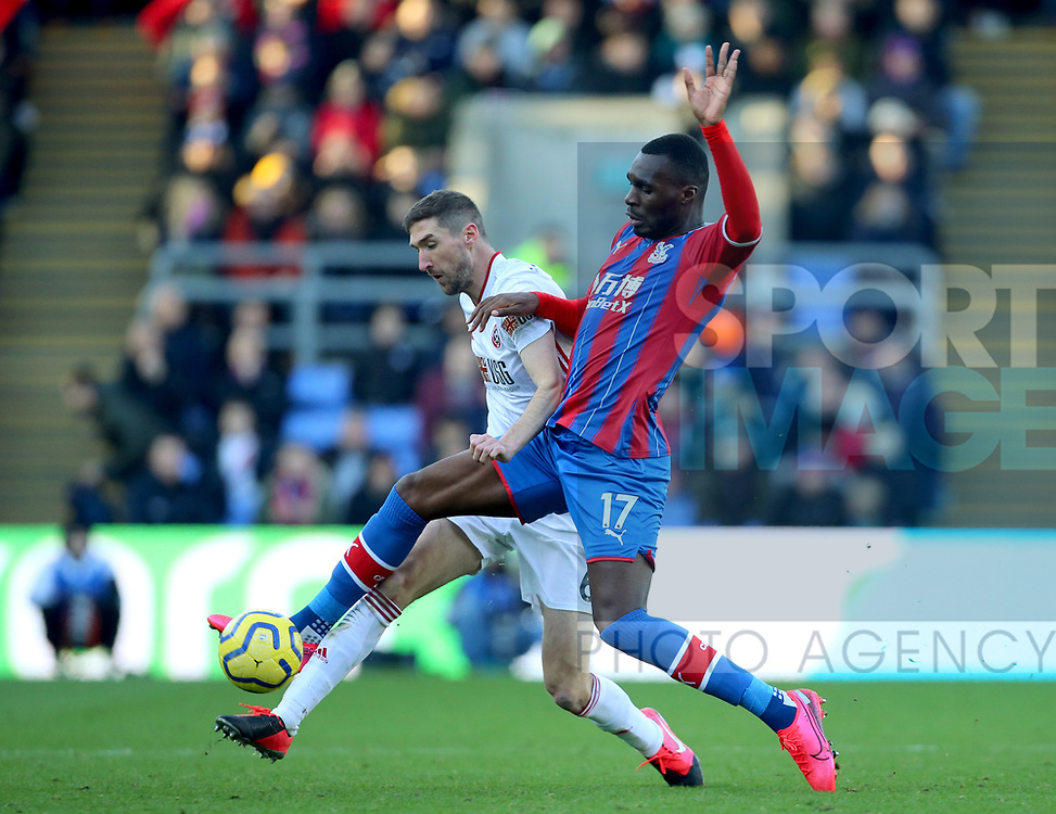 Chris Basham of Sheffield Utd challenges Christian Benteke of Crystal Palace during the Premier League match at Selhurst Park, London. Picture date: 1st February 2020. Picture credit should read: Paul Terry/Sportimage