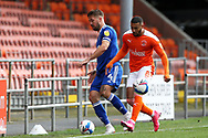 Keep your eye on the ball - Ipswich Town defender Luke Chambers (4) and Blackpool forward Keshi Anderson (8) during the EFL Sky Bet League 1 match between Blackpool and Ipswich Town at Bloomfield Road, Blackpool, England on 10 October 2020.