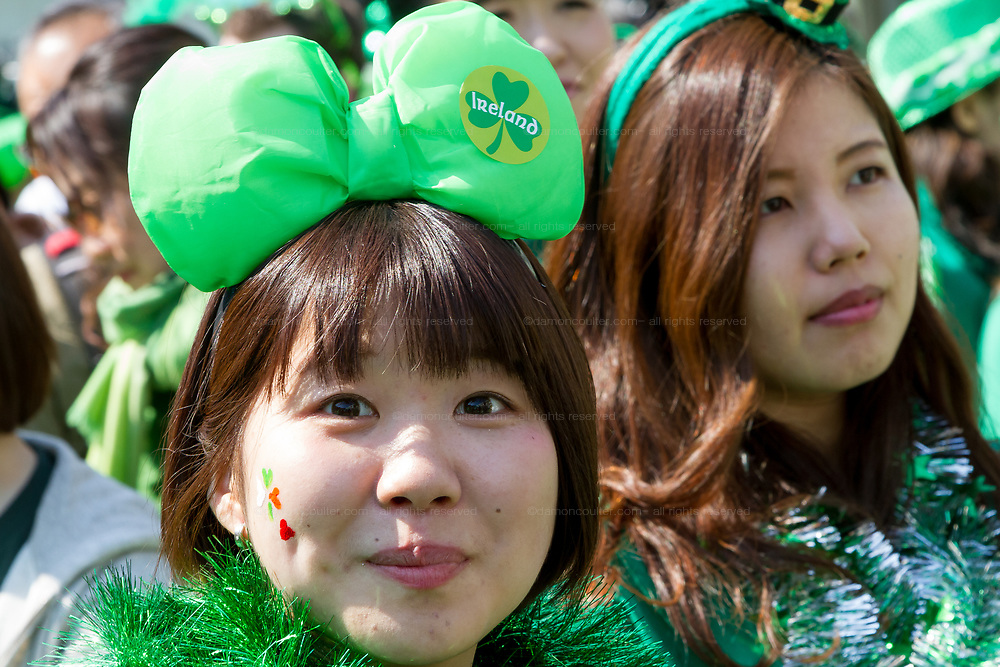 "People dressed in green enjoy the 27th Saint .Patrick's Day Parade in Omotesando, Tokyo, Japan. Sunday March 17th 2019. Started in 1992 by the Irish Network, Japan, and supported by the Embassy of Ireland,; the parade, along with the ""I Love Ireland Festival"" held nearby is Asia's  largest Irish event."