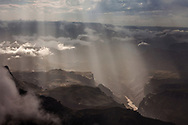 light beaming into Seventy Five mile rapid in Grand Canyon.