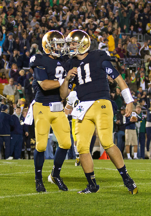September 22, 2012:  Notre Dame quarterback Tommy Rees (11) and Notre Dame wide receiver Robby Toma (9) celebrate touchdown during NCAA Football game action between the Notre Dame Fighting Irish and the Michigan Wolverines at Notre Dame Stadium in South Bend, Indiana.  Notre Dame defeated Michigan 13-6.