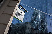 The brand of Lloyds Bank, a black horse, and background banks and insurance headquarters including the Swiss Re building aka The Gherkin in the capitals oldest financial district, The Square Mile, on 14th August 2017, in the City of London, England.