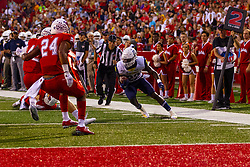 NORMAL, IL - September 21: Joe Logan looking for a way past Dylan Draka and Christian Uphoff during a college football game between the ISU (Illinois State University) Redbirds and the Northern Arizona University (NAU) Lumberjacks on September 21 2019 at Hancock Stadium in Normal, IL. (Photo by Alan Look)