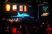 The grand unveiling of Eurofighter (now called Typhoon) the fighter jet built by a consortium of European nation aerospace companies, on 27th March 1994, in Warton, England. With VIPs and special military guests present to celebrate this success of the aviation defence project, the flags of contributing countries hang above at a hangar at the BAE Systems factory at Warton. The Eurofighter Typhoon is a twin-engine, canard-delta wing, multirole combat aircraft, designed and built by a consortium of three companies. Its maiden flight took place on 27 March 1994. (Photo by Richard Baker / In Pictures via Getty Images)