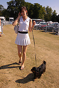 Ava Bergman and 'Jeffrey'. Veuve Clicquot Gold Cup Final at Cowdray Park. Midhurst. 17 July 2005. ONE TIME USE ONLY - DO NOT ARCHIVE  © Copyright Photograph by Dafydd Jones 66 Stockwell Park Rd. London SW9 0DA Tel 020 7733 0108 www.dafjones.com
