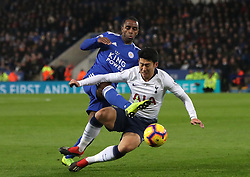 Tottenham Hotspur's Son Heung-min (right) and Leicester City's Kelechi Iheanacho battle for the ball