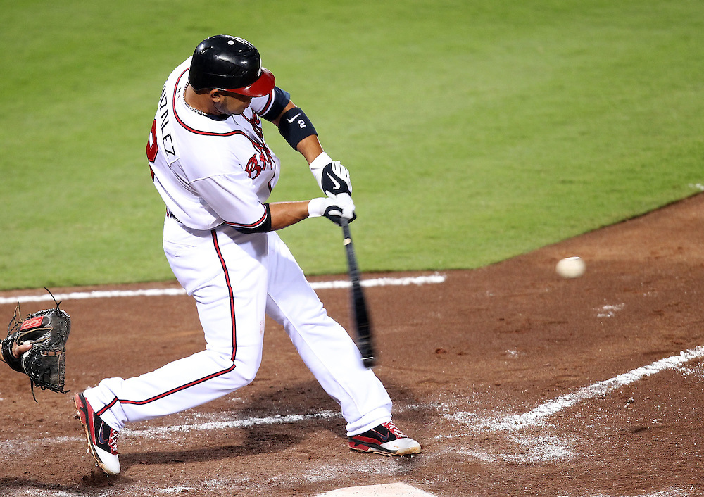 ATLANTA, GA - AUGUST 30:  Shortstop Alex Gonzalez #2 of the Atlanta Braves hits a double during the game against the Washington Nationals during the game at Turner Field on August 30, 2011 in Atlanta, Georgia.  (Photo by Mike Zarrilli/Getty Images)