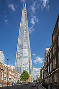 The Shard and clouds against blue sky seen from St Thomas, Street. Southwark, May 2015, London. Architect: Renzo Piano. Engineer: WSP Global