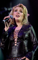Kim Wilde steps out of the her TV Gardening clothes and Back on Stage to Tour with<br /><br />Steve Starnge (Visage)<br />Claire Grogan (Altered Images)<br />The Belle Stars<br />Dollar<br />Kim Wilde<br />The Human League<br />Play on the Here and Now  Christmas Party Tour at Sheffields Hallam FM Arena Friday 13th December 2002<br /><br />[#Beginning of Shooting Data Section]<br />Nikon D1 <br />2002/12/13 22:40:12.1<br />JPEG (8-bit) Fine<br />Image Size:  2000 x 1312<br />Color<br />Lens: 80-200mm f/2.8-2.8<br />Focal Length: 112mm<br />Exposure Mode: Manual<br />Metering Mode: Spot<br />1/200 sec - f/2.8<br />Exposure Comp.: 0 EV<br />Sensitivity: ISO 800<br />White Balance: Auto<br />AF Mode: AF-S<br />Tone Comp: Normal<br />Flash Sync Mode: Not Attached<br />Color Mode: <br />Hue Adjustment: <br />Sharpening: Normal<br />Noise Reduction: <br />Image Comment: <br />[#End of Shooting Data Section]