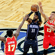 ORLANDO, FL - MARCH 03: Terrence Ross #31 of the Orlando Magic attempts a shot as Onyeka Okongwu #17 of the Atlanta Hawks and Bogdan Bogdanovic #13 of the Atlanta Hawks defend during the first half at Amway Center on March 3, 2021 in Orlando, Florida. NOTE TO USER: User expressly acknowledges and agrees that, by downloading and or using this photograph, User is consenting to the terms and conditions of the Getty Images License Agreement. (Photo by Alex Menendez/Getty Images)*** Local Caption *** Terrence Ross; Onyeka Okongwu; Bogdan Bogdanovic