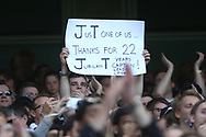 a Chelsea fan holds up a message as tribute to Chelsea Captain John Terry as he leaves the field.  Premier league match, Chelsea v Sunderland at Stamford Bridge in London on Sunday 21st May 2017.<br /> pic by Steffan Bowen,  Andrew Orchard sports photography.