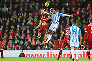 Ragnar Klavan of Liverpool (l) and Steve Mounie of Huddersfield Town jump for the ball. Premier League match, Liverpool v Huddersfield Town at the Anfield stadium in Liverpool, Merseyside on Saturday 28th October 2017.<br /> pic by Chris Stading, Andrew Orchard sports photography.