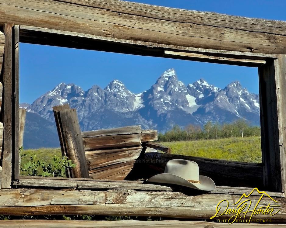 """Derilict log cabin, Cowboy hat, Grand Teton National Park, Jackson Hole, Wyoming. This was the cabin used in the movie """"Shane"""" 1954 starring Allan Ladd.<br /> <br /> For production prints or stock photos click the Purchase Print/License Photo Button in upper Right; for Fine Art """"Custom Prints"""" contact Daryl - 208-709-3250 or dh@greater-yellowstone.com"""