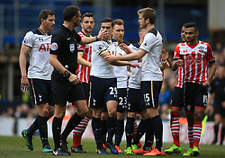 19 March 2017 - Premier League - Tottenham Hotspur v Southampton - Referee Andre Marriner ushers the players toward him after Harry Winks of Tottenham Hotspur and Sofiane Boufal of Southampton clash - Photo: Marc Atkins / Offside.
