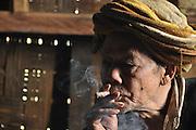 Myanmar, portrait of a mature man smoking a cigar