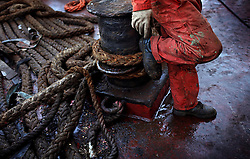 The Alfa K, a Mediterranean based bulk carrier with a Panamanian flag, undergoes repairs at the port of Piraeus in Greece on Feb. 20, 2008. Inspectors impose ITF-standard treaties on ship-owners to guarantee minimal standard working conditions for seafarers. They are on call 24 hours a day to address concerns from workers coming to port on the international ships.