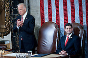Vice President Joe Biden applauds and Speaker of the House Paul Ryan looks out at the chamber as U.S. President Barack Obama speaks about makeing college affordable for all as he delivers the State of the Union address to a joint session of Congress at the Capitol in Washington, D.C., U.S., on Tuesday, Jan. 12, 2016. Obama said he regrets that political divisiveness in the U.S. grew during his seven years in the White House and he plans to use his final State of the Union address Tuesday night to call for the nation to unite. Photographer: Pete Marovich/Bloomberg *** Local Caption *** Barack Obama