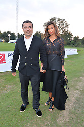 NASIB PIRIYEV and his wife OLENA at the Chovgan Twilight Polo Gala in association with the PNN Group held at Ham Polo Club, Petersham Close, Richmond, Surrey on 10th September 2014.