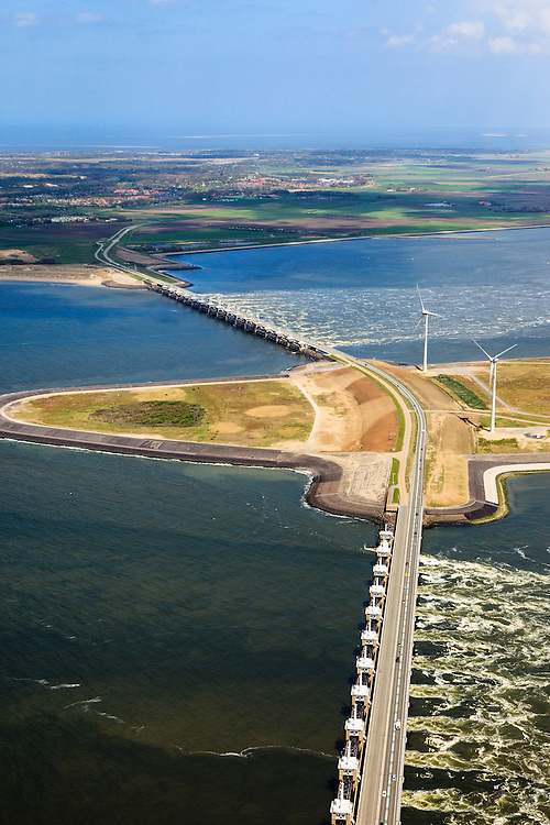 Nederland, Zeeland, Oosterschelde, 09-05-2013; Oosterschelde Stormvloedkering tussen Schouwen en Noord-Beveland met inkomend tij. Sluitgat Schaar (voorgrond), werkeiland Roggenplaat, Sluitgat Hammen en Schouwen-Duiveland in de achtergrond. Links van de kering de de Noordzee..Storm surge barrier in Oosterschelde (East Scheldt), between Islands of Schouwen-Duiveland and Noord-Beveland; North Sea on the right side of the barrier. Under normal circumstances the barrier is open to allow for the tide to enter and exit. In case of high tides in combination with storm, the slides are closed..luchtfoto (toeslag op standard tarieven).aerial photo (additional fee required).copyright foto/photo Siebe Swart