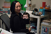 AUSTIN, TEXAS - FEBRUARY 9: Jinny Suh poses with with her 4-month-old son at her home in Austin, Texas on February 9, 2017. Jinny is a pro-vaccine advocate in addition to running her own businesses from home and raising her two sons. (Photo by Cooper Neill for The Washington Post)