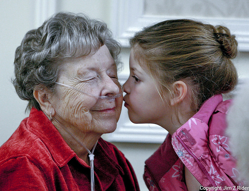 Madison Baker, 7, of Elkhart, Indiana, kisses her great-grandmother, Lois Wilson, 84, goodbye during St. Paul's annual Holiday Gala.  Wilson is a resident at St. Paul's, a retirement home in South Bend.