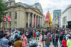 © Licensed to London News Pictures. 08/08/2021. LONDON, UK.  Hare Krishna devotees take part in the Rathayatra Festival, or Festival of the Chariots.  This year only one decorated chariot (pictured) (usually three) was wheeled from Hyde Park to Trafalgar Square.  Once in the square, devotees enjoy free vegetarian food and refreshments during the festival.  Photo credit: Stephen Chung/LNP