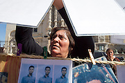 Maria Esperanza Blandón García, from Chinandega, north of Nicaragua, hangs a picture in the streets of Saltillo, Coahuila, on October 21st, 2012 (Photo: Prometeo Lucero)