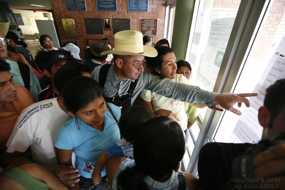 Families look to see if their child has made it onto the surgery schedule at the Hospital Japones in Santa Cruz, Bolivia on Saturday, November 10, 2007, during Operation Smile's World Journey of Smiles...Photograph by Erin Lubin